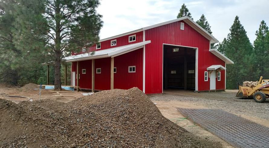 Agricultural equestrian buildings including steel for Red metal barn